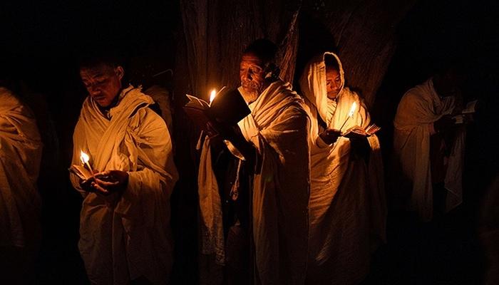 """Pigrims pray by candlelight"", Carl de Souza, 2013."